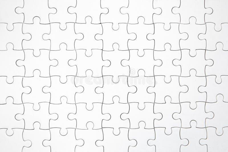 Hoogste mening die van witte figuurzaag puzzel achtergrond wordt geschoten stock afbeeldingen