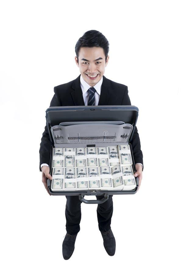 Hoogste mening met de jonge zakenman die volledige dollars in Brie houden stock afbeeldingen