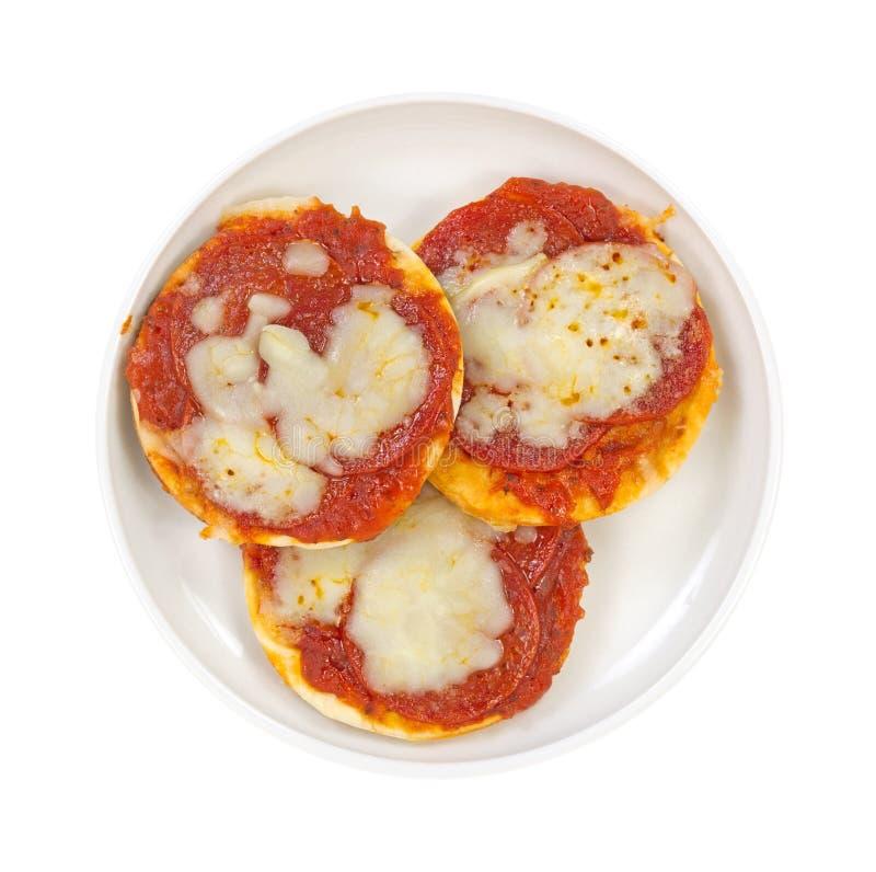Hoogste mening van drie pizza's in een kleine schotel royalty-vrije stock foto's