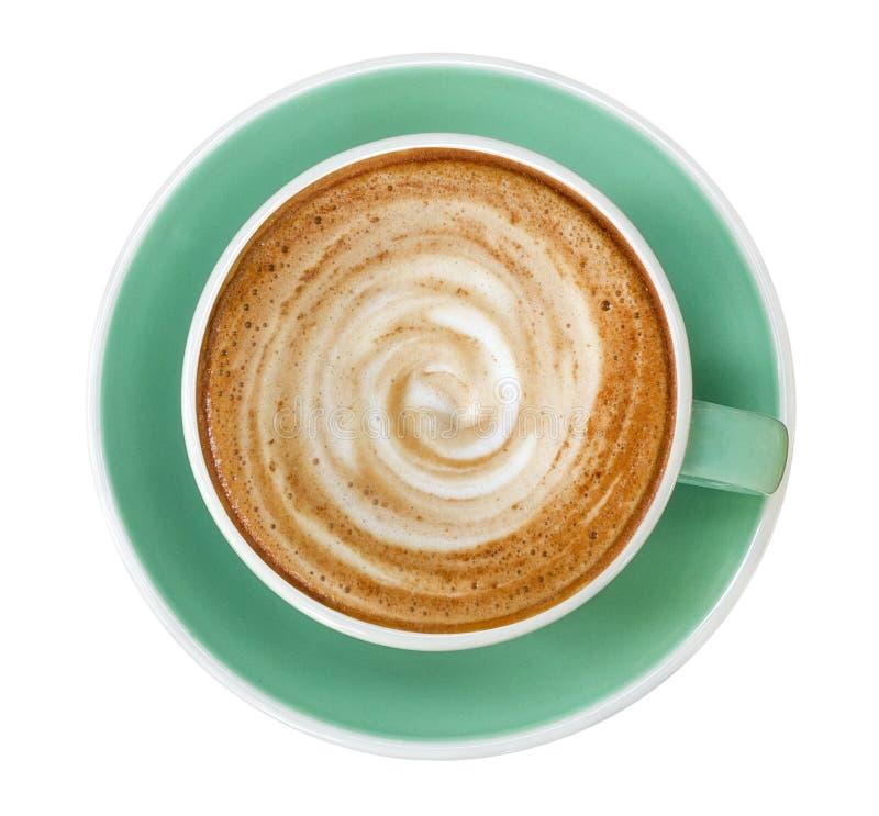 Hoogste mening van heet de kunst spiraalvormig schuim van de koffiecappuccino latte in de kop van de jadekleur die op witte achte stock afbeeldingen