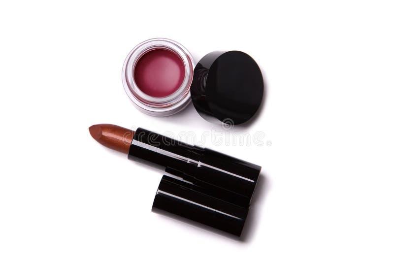 Hoogste mening van metaal rode lippenstift en lipgloss in kruik royalty-vrije stock fotografie