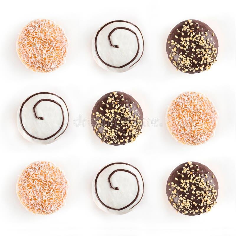 Hoogste mening van negen doughnuts verschillende die soorten op witte achtergrond worden geïsoleerd royalty-vrije stock foto