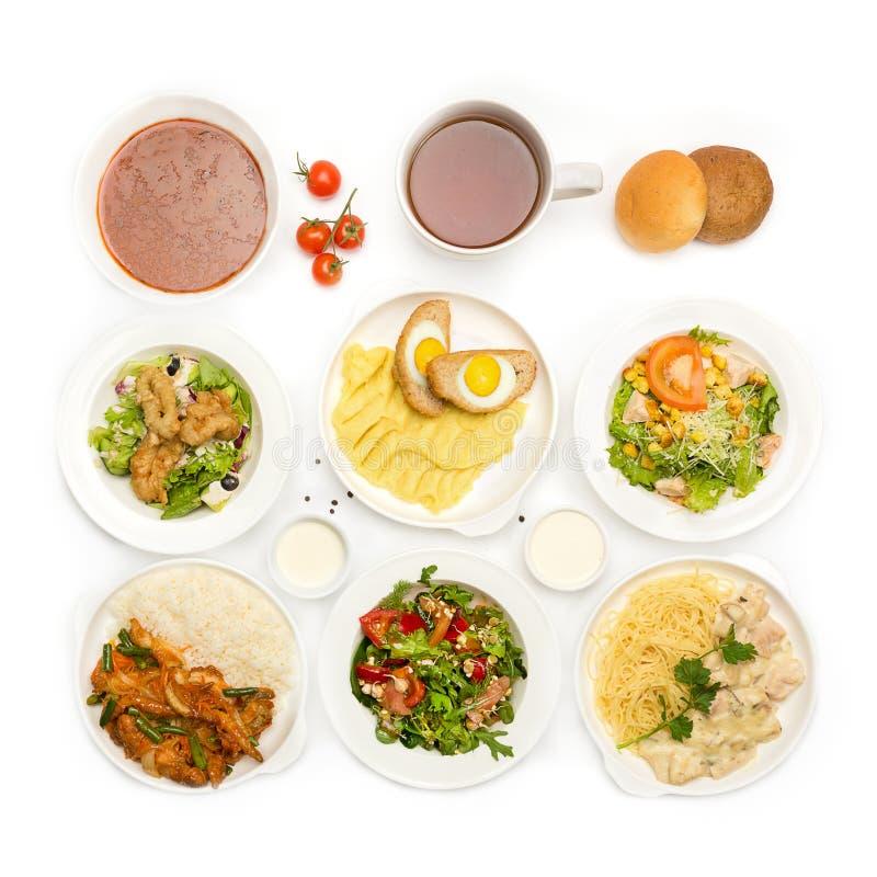 Hoogste mening van vele platen met voedsel royalty-vrije stock afbeeldingen