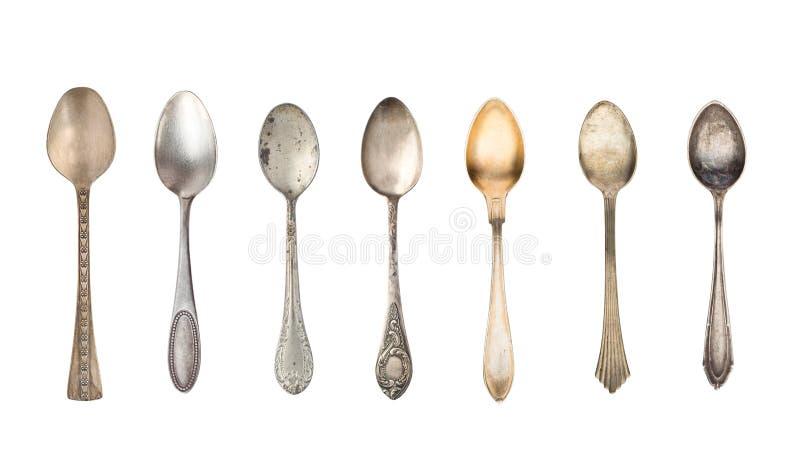 Hoogste mening van zeven oude zilveren mooie die theelepels op witte achtergrond wordt geïsoleerd royalty-vrije stock afbeeldingen