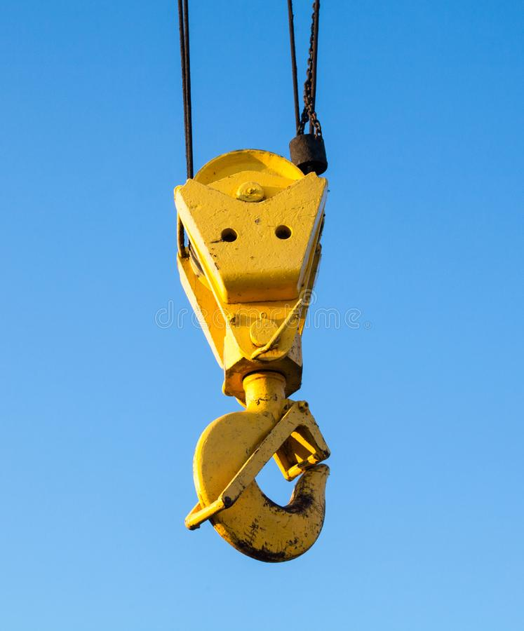 Hook of the crane. Against the blue sky. Construction site. Building machine. Close-up royalty free stock photos