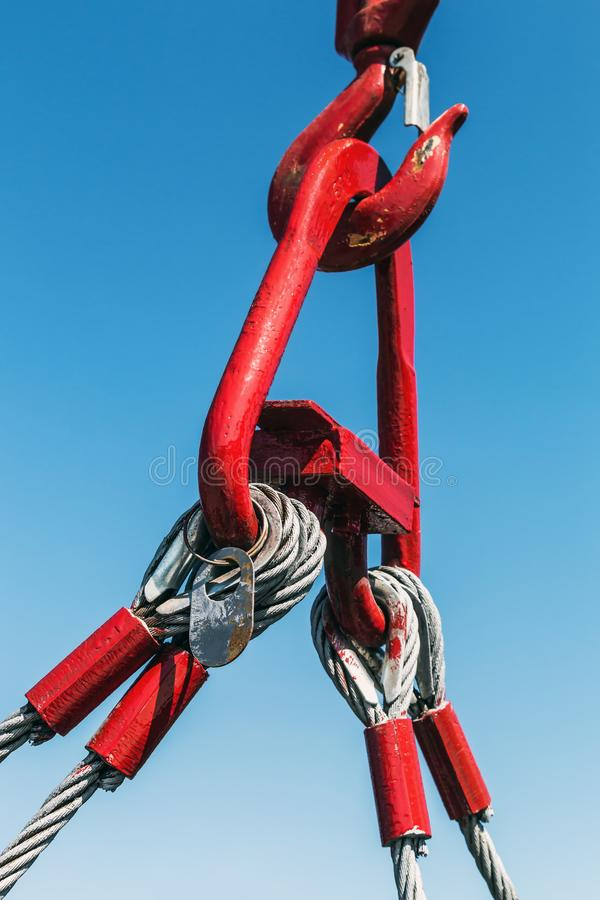 Hook of a crane lifts a load royalty free stock photography