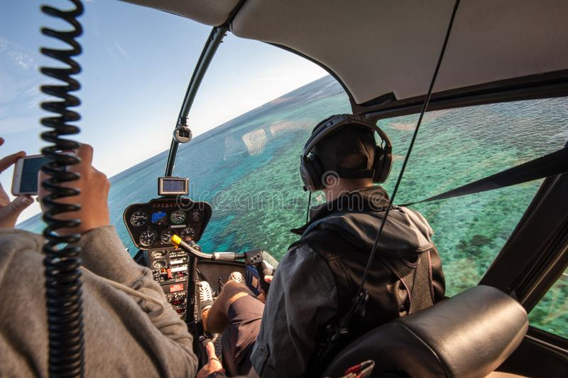 View from helicopter landing at Hook Reef, Great Barrier Reef, Whitsunday Islands. Hook Reef, Whitsunday Island, Queensland, Australia - July 15 2015: View from stock photo