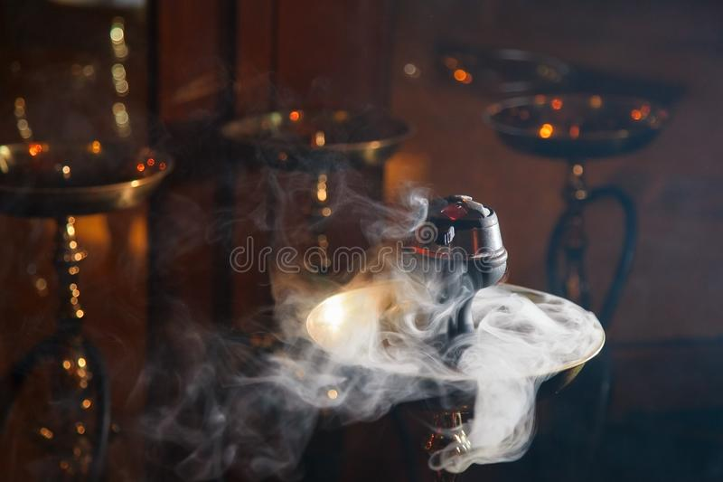 Hookah. Beautiful smoke in the bowl of a hookah. close-up royalty free stock images