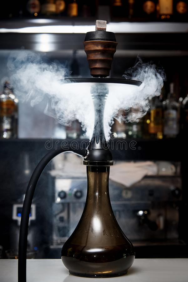 Hookah in a cloud of smoke. On the bar stock images