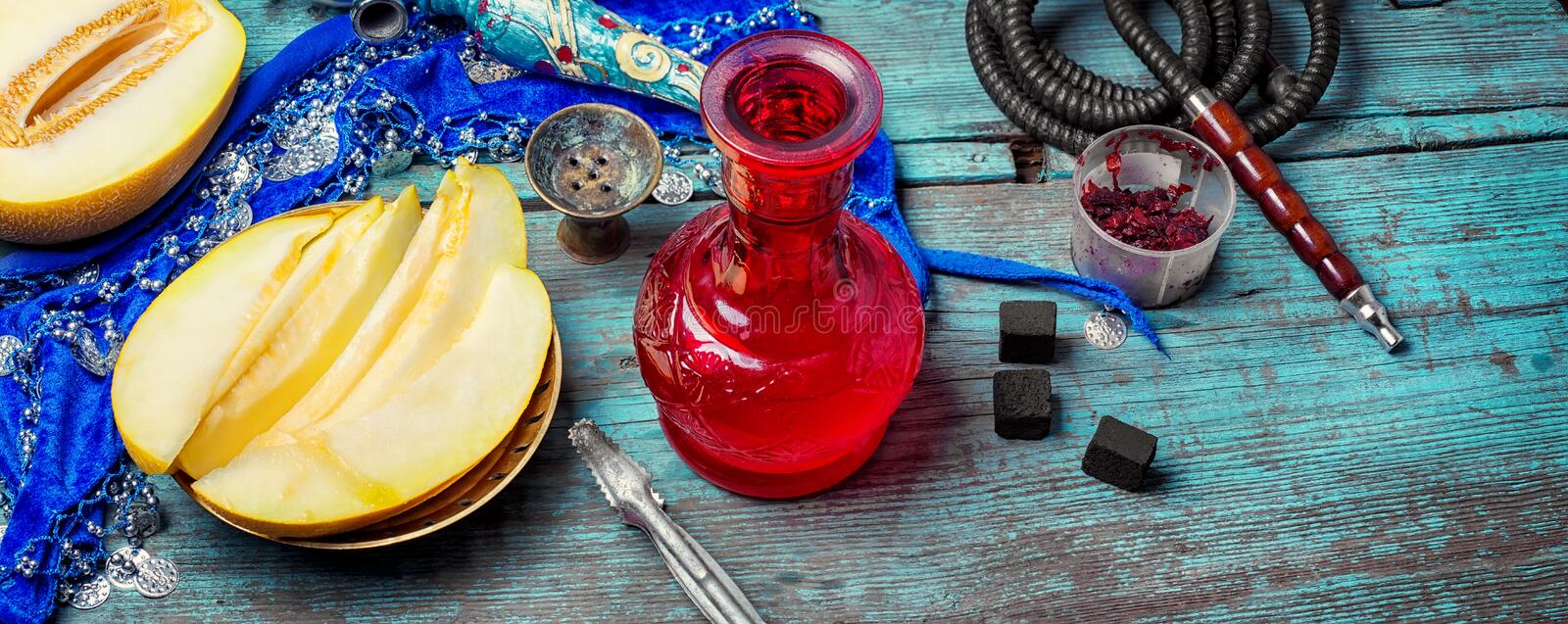 Hookah and melon. Melon variety of hookah tobacco and smoking accessories royalty free stock photos