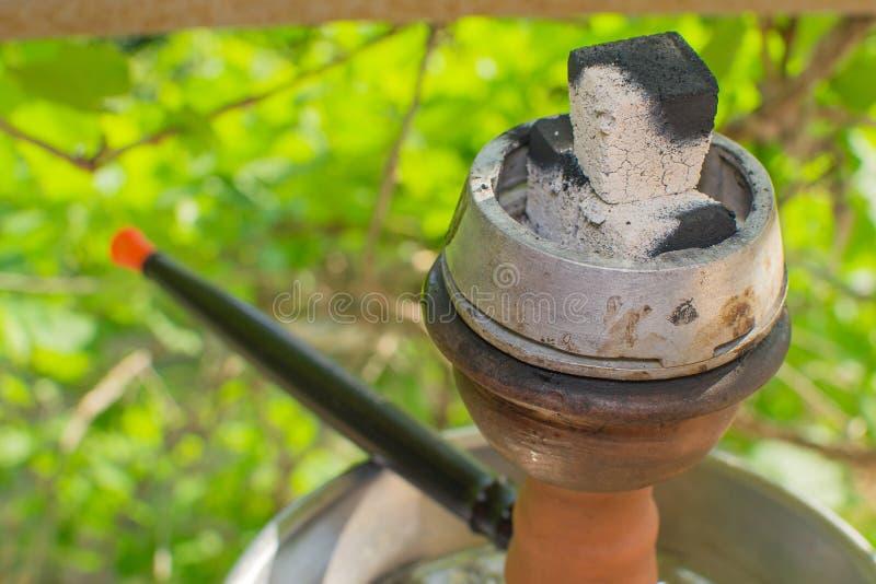 Hookah in nature. Hookah on the nature of hookah Smoking smoke outdoors stock image