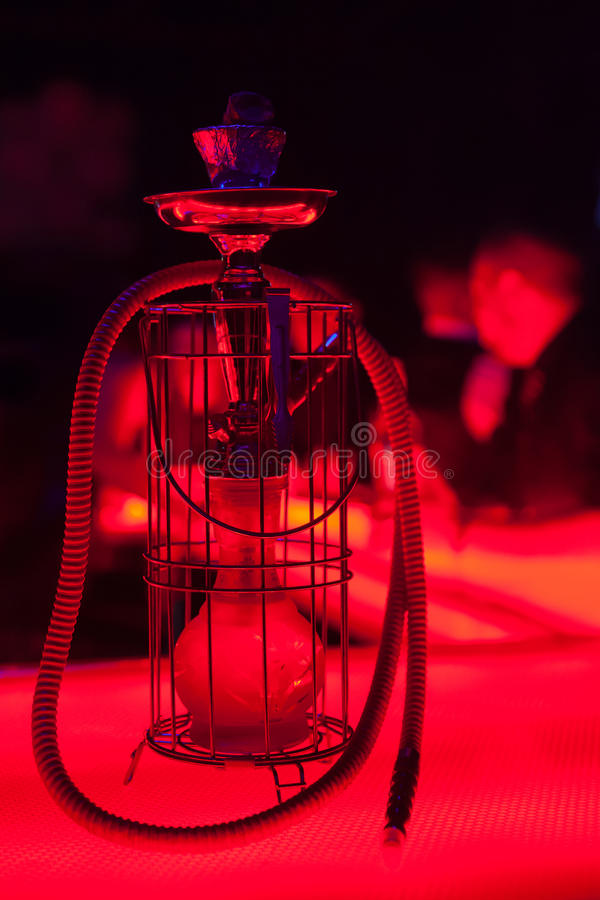 Hookah with strong red lighting. Hookah in the night club stock images