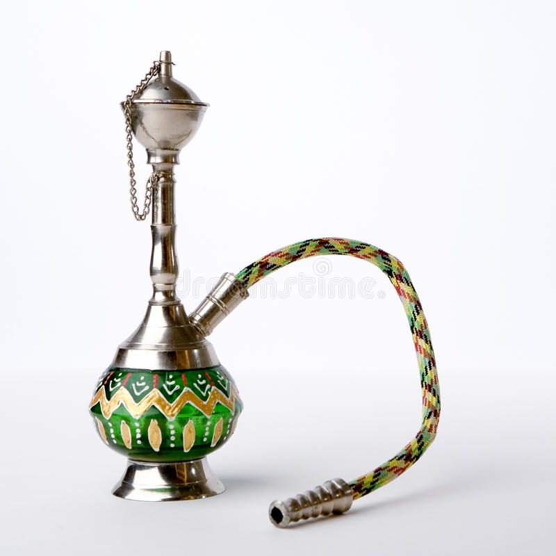 Hookah pipe. A small hookah pipe, also known as a shisha, isolated against a white background stock photography