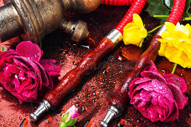 Hookah with rose tobacco. Smoking hookah with floral tobacco flavor.Nargile.Shisha hookah with flower royalty free stock images