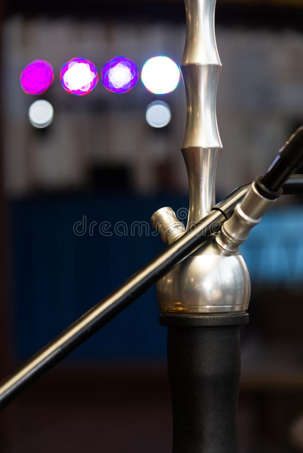 A hookah smokes. On a blurred background stock images