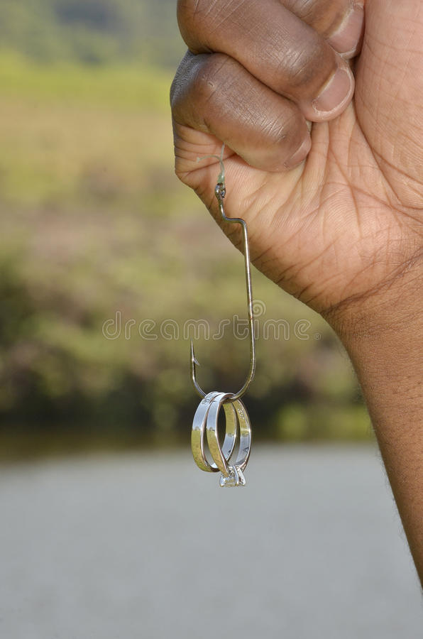 Hooked on Love fishing theme royalty free stock photography