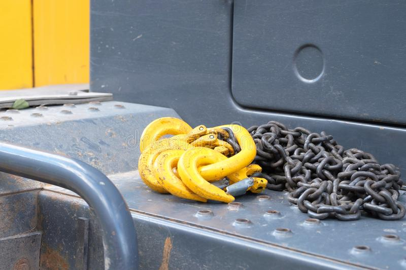 Hooks made of metal for lifting loads of yellow lie on the truck. Metal objects stock photo