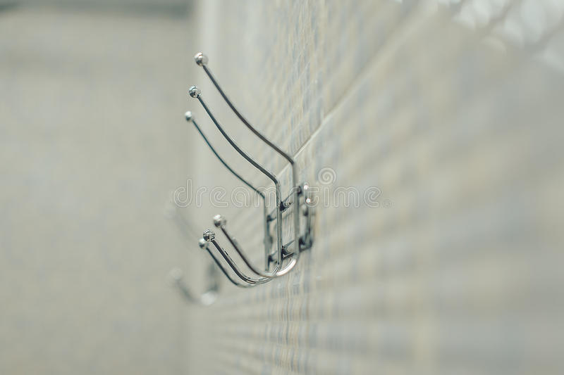 Hooks for towels on the board. Close royalty free stock image