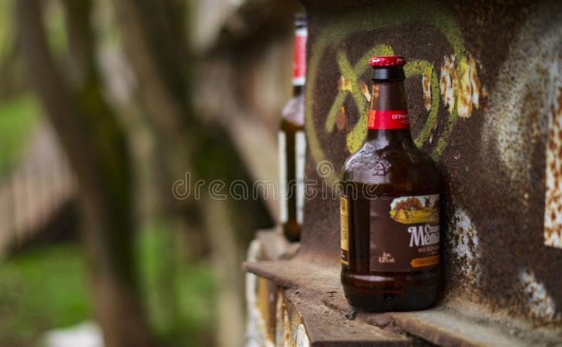 Hooligans left beer bottles right on the street royalty free stock images