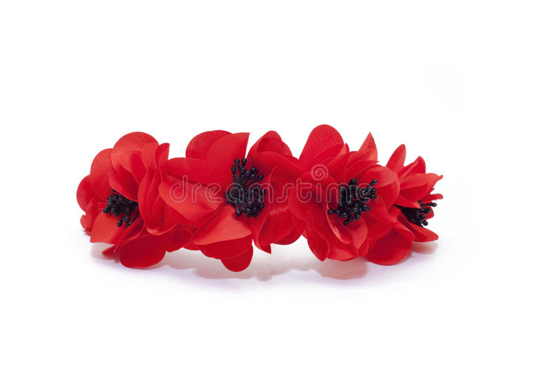 A hoop on the head of red poppies stock image