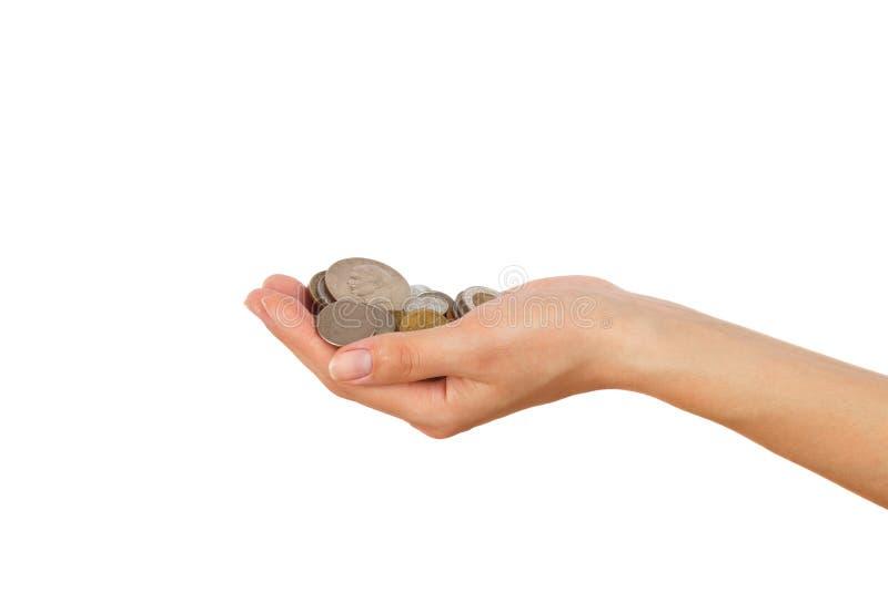 Hoop van muntstukken in de geïsoleerde vrouwen` s hand, royalty-vrije stock afbeelding