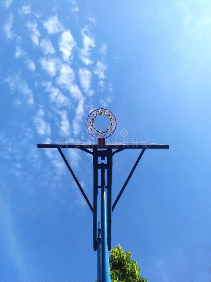 Hoops and clouds. Basketball hoops and clouds in the afternoon stock photography