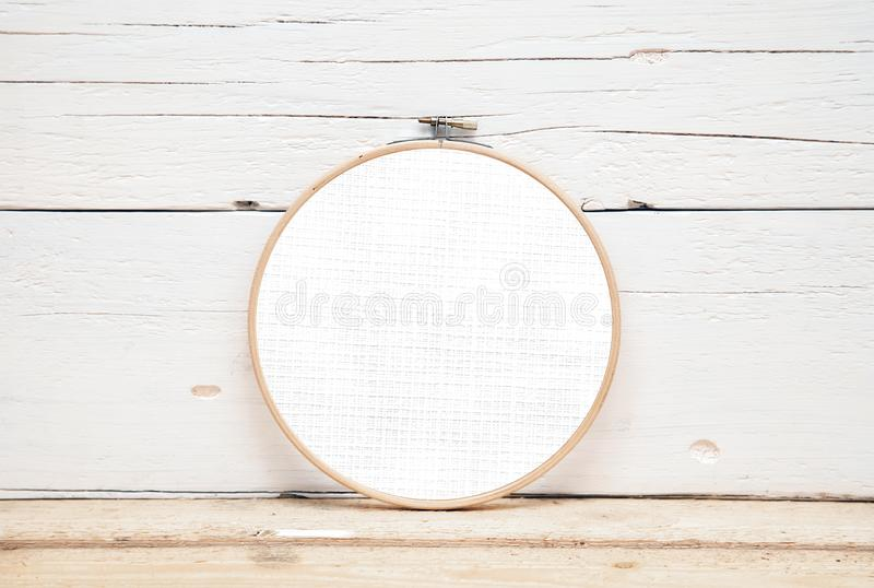Hoops for embroidery on a wooden background - a round layout for embroidery. Round hoops for embroidery - a direct view stock image