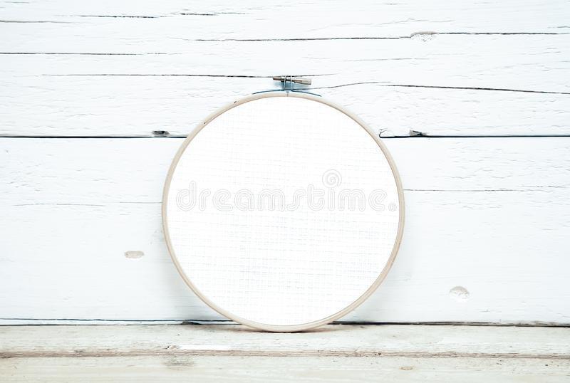 Hoops for embroidery on a wooden background - a round layout for embroidery - round hoops for embroidery. A direct view royalty free stock image