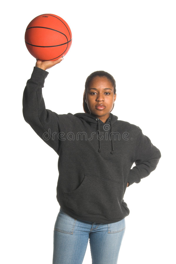 Hoops Girl. Inner city African American woman in jeans and a sweat shirt playing basketball stock images