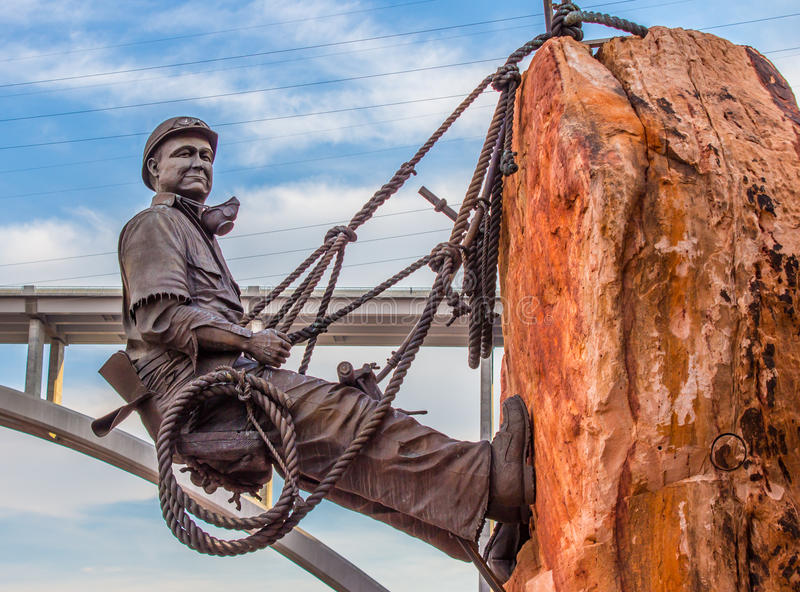 Hoover Dam High Scaler Joe Kine. During the construction of Hoover Dam there were few jobs that equaled the high visibility of the high scaler. A man hanging stock photo
