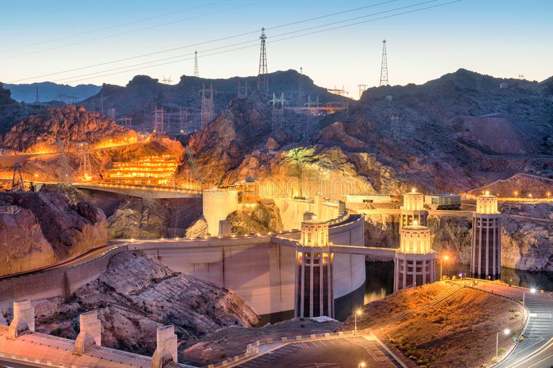 Hoover Dam at Twilight. Hooover Dam on the Colorado River straddling Nevada and Arizona at dusk stock photo