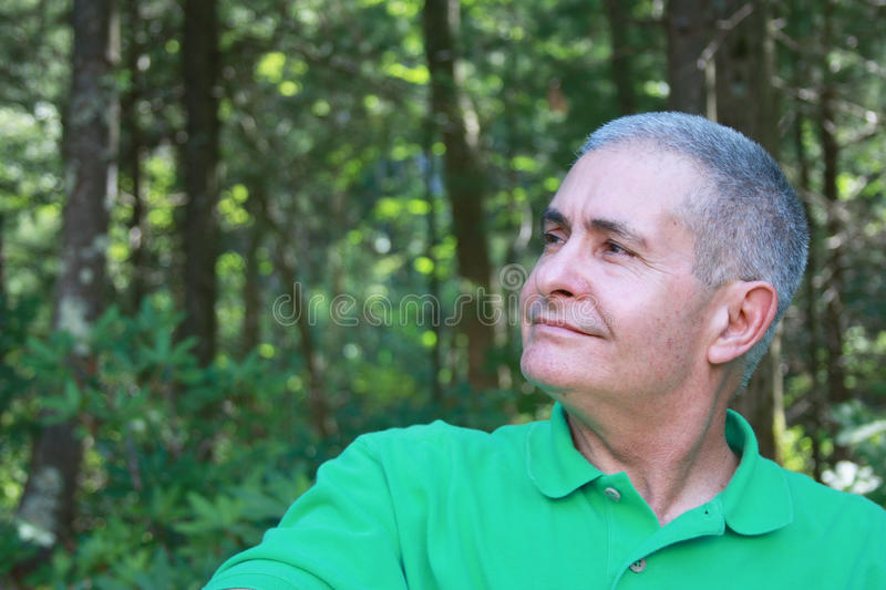 Hope. An elderly man is looking up the sky, healthy, happy, proud of his own life royalty free stock photography