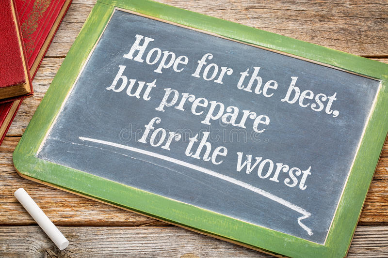 Hope for the best but prepare ... Hope for the best but prepare for the worst - advice on a slate blackboard with a white chalk and a stack of books against royalty free stock photo