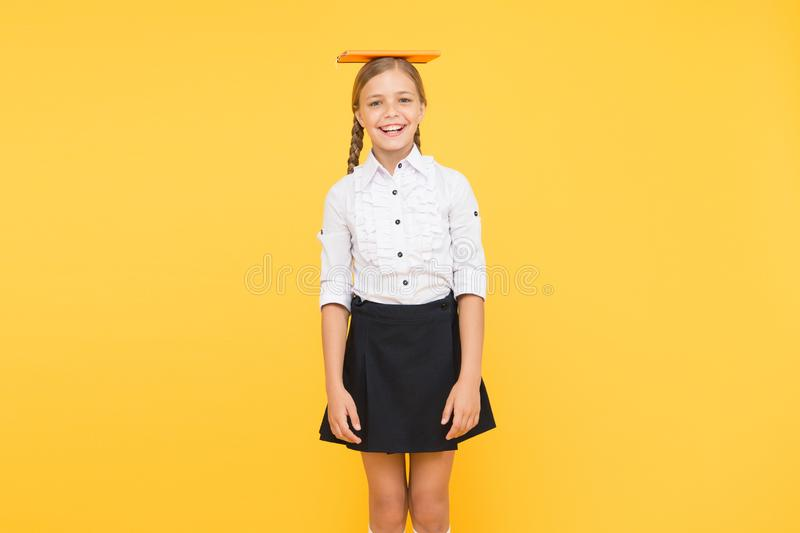 Hope for best. School girl studying textbook. Kid school uniform hold book. Life balance positivity. Dealing with school. Stress. Practice meditation. Find royalty free stock photo