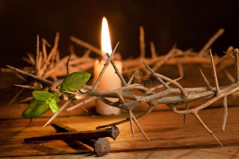 Hope with Easter. Candle burning in a crown of thorns at Easter