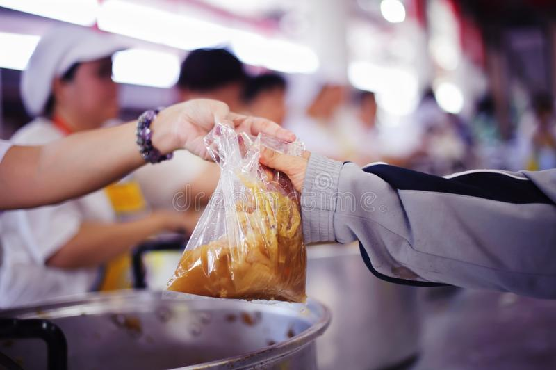 The Hope of the Poor by Donating Charity Food to the Immaculate : The Concept of Mindfulness royalty free stock images