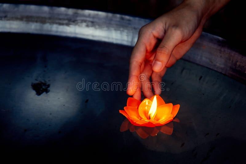 Hope, Prayer. Candlelight navigate these Buddhists stock photography