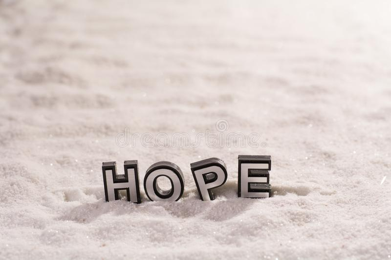 Hope word on white sand royalty free stock photography