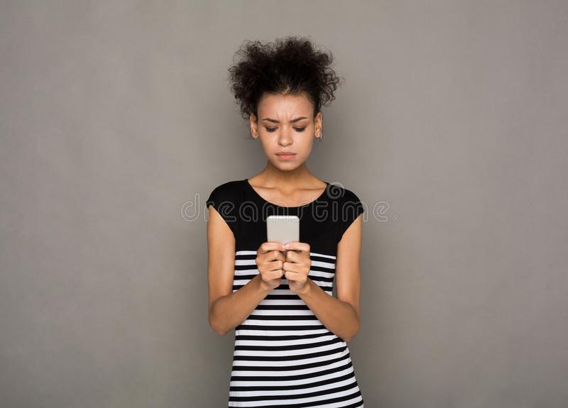 Hopeful african-american woman wait for call royalty free stock photography