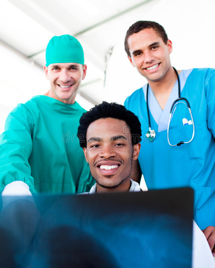 Hopeful male doctors looking at X-Ray royalty free stock photography