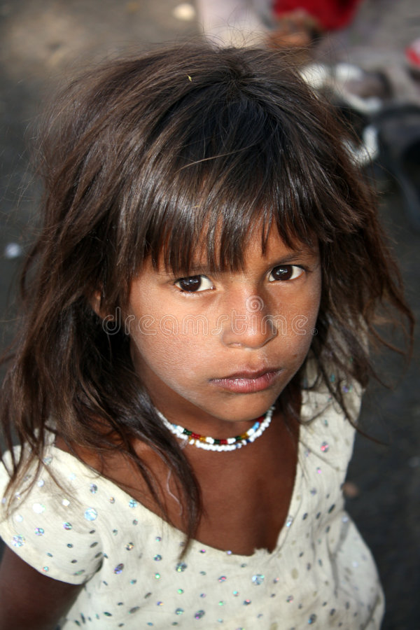 Hopeful Poor Indian Girl Stock Photo