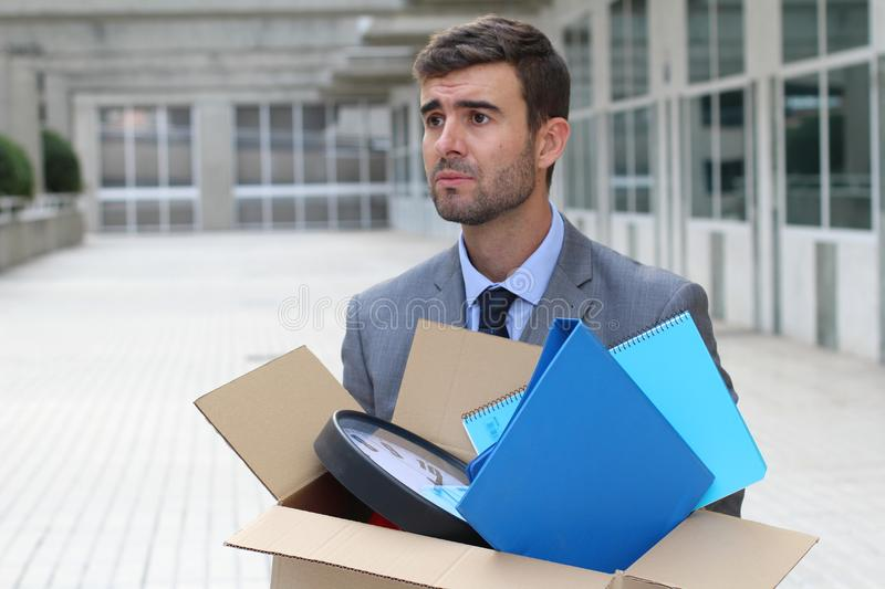 Hopeless businessman getting fired isolated royalty free stock images