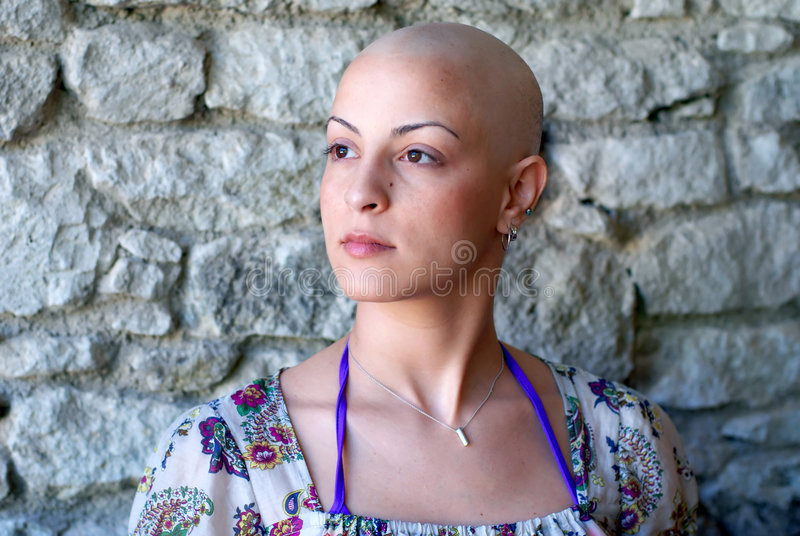 Hopes and wills for future. Cancer patient concerns for her future, specially focused on right side of her face royalty free stock image