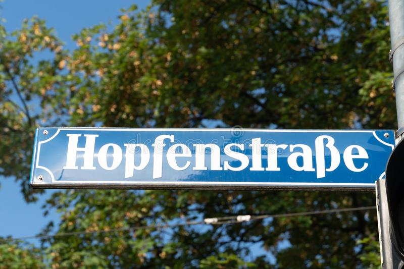 Hopfenstrasse street name sign, Munich, Germany. Hopfenstraße street name sign, near the main station of the Bavarian city of Munich, Germany stock image