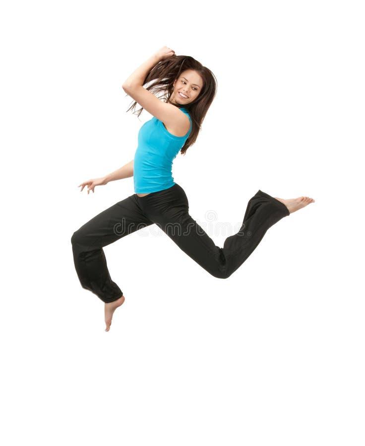 Hoppa den sportiga flickan royaltyfri fotografi