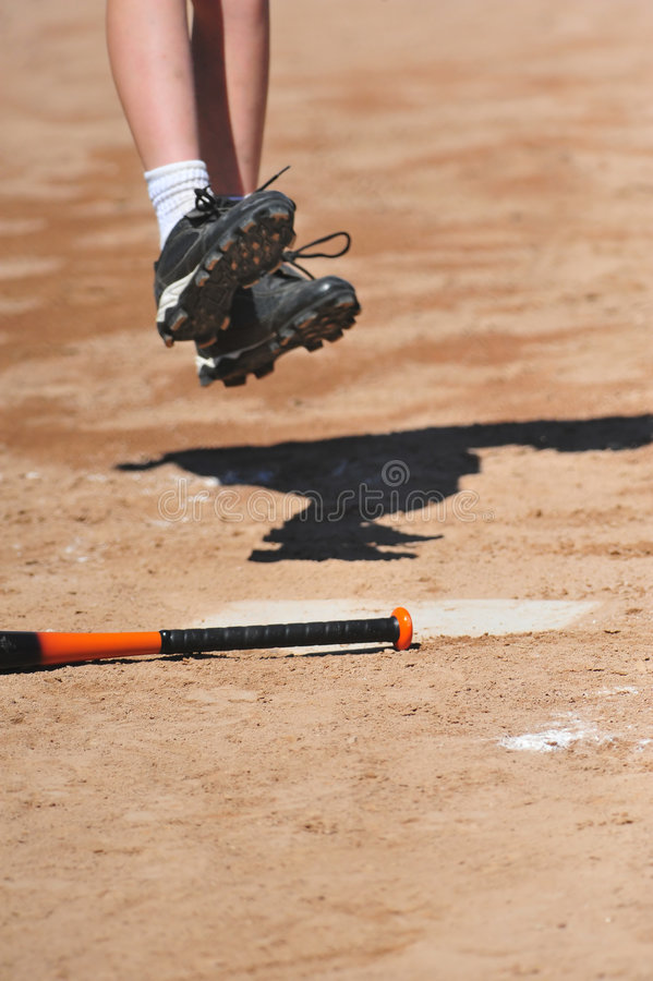 Hopping Onto Home Plate Royalty Free Stock Image