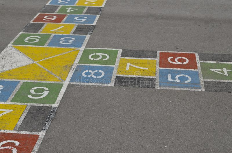 Hopscotch court with numbers from 1 to 9 drawn with paint stock image