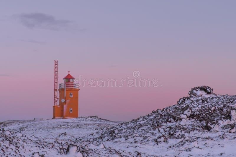 Hopsnes Lighthouse, on the Reykjanes Peninsula in Iceland at twilight royalty free stock image
