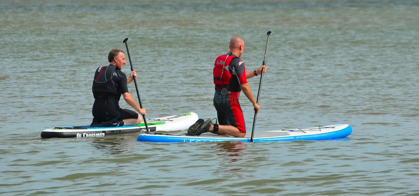 Men on inflatable paddle boards on the north sea. royalty free stock images