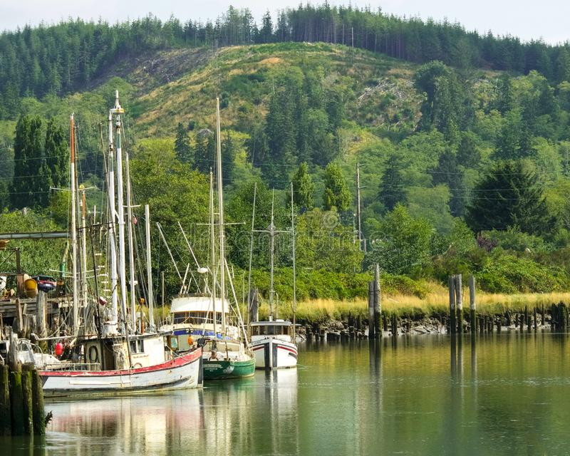 HOQUIAM, WASHINGTON: AUGUST 2017: Local fishing boats sit in the bend of the Hoquiam River in Grays Harbor County, Washington. Local fishing boats moored in the royalty free stock images